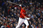 Boston Red Sox's J.D. Martinez follows through on his two-run home run against the Colorado Rockies during the third inning of a baseball game Wednesday, May 15, 2019, at Fenway Park in Boston. (AP Photo/Winslow Townson)