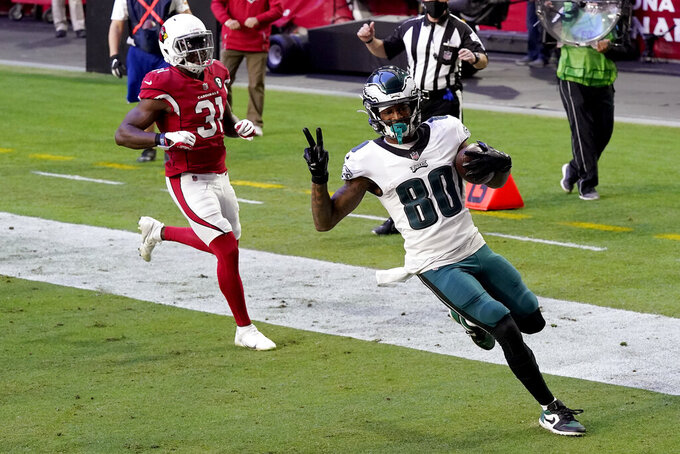 Philadelphia Eagles wide receiver Quez Watkins (80) scores a touchdown as Arizona Cardinals free safety Chris Banjo (31) defends during the first half of an NFL football game, Sunday, Dec. 20, 2020, in Glendale, Ariz. (AP Photo/Ross D. Franklin)