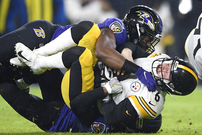 FILE - In this Dec. 29, 2019, file photo, Pittsburgh Steelers quarterback Devlin Hodges (6) is sacked by Baltimore Ravens cornerback Brandon Carr, bottom and outside linebacker Matthew Judon, top, during the first half of an NFL football game, in Baltimore. The Ravens have placed the franchise tag on outside linebacker Matthew Judon, a sack specialist who was sure to garner plenty of attention from around the league next week as an unrestricted free agent. By designating Judon as the 2020 franchise player, the Ravens have additional time to work out a long-term deal with their fifth-round pick in the 2016 draft after the start of free agency on Monday, March 16, 2020. (AP Photo/Nick Wass, File)