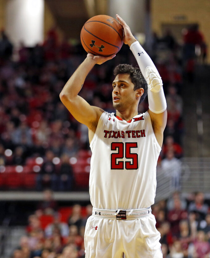 Texas Tech's Davide Moretti shoots a 3-pointer against Oklahoma during the first half of an NBA basketball game Tuesday, Jan. 8, 2019, in Lubbock, Texas. (AP Photo/Brad Tollefson)