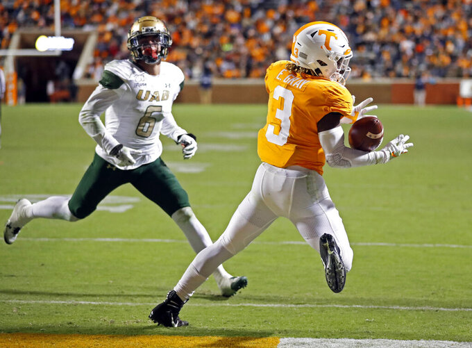 Tennessee running back Eric Gray (3) catches a pass for a touchdown as he's defended by UAB linebacker Kristopher Moll (6) in the second half of an NCAA college football game, Saturday, Nov. 2, 2019, in Knoxville, Tenn. (AP Photo/Wade Payne)