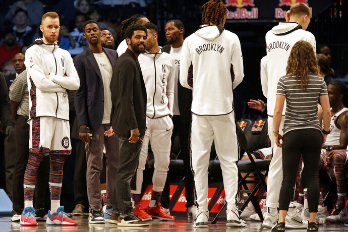 Brooklyn Nets guard Kyrie Irving looks on during the second half of an NBA basketball game against the Boston Celtics on Friday, Nov. 29, 2019, in New York. The Nets won 112-107. (AP Photo/Adam Hunger)