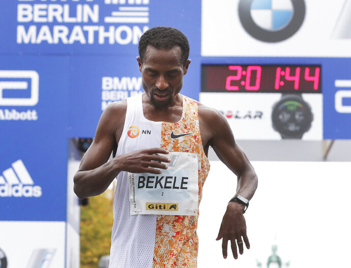 Ethiopia's Kenenisa Bekele has crossed the finish line to win the 46th Berlin marathon in Berlin, Germany, Sunday, Sept. 29, 2019. (AP Photo/Michael Sohn)