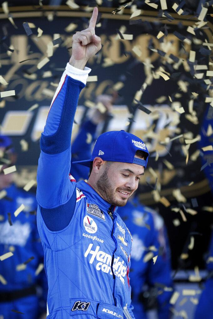 Kyle Larson celebrates after winning a NASCAR Cup Series auto race at Kansas Speedway in Kansas City, Kan., Sunday, Oct. 24, 2021. (AP Photo/Colin E. Braley)