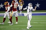 Dallas Cowboys quarterback Andy Dalton (14) gestures after throwing an incomplete pass into the end zone as Washington Football Team's Tim Settle (97) and Ryan Kerrigan (91) walk past in the second half of an NFL football game in Arlington, Texas, Thursday, Nov. 26, 2020. (AP Photo/Roger Steinman)