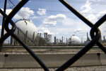 FILE - In this July 11, 2012 file photo the Marcus Hook Refinery is seen through a fence, in Marcus Hook, Pa. The FBI is investigating how Gov. Tom Wolf's administration came to issue permits for construction on a multibillion-dollar pipeline to carry natural gas liquids across Pennsylvania, The Associated Press has learned.  (AP Photo/Matt Slocum, File)