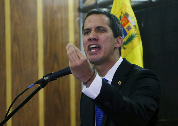 Venezuela's opposition leader and self-proclaimed interim president Juan Guaidó speaks during a meeting with the  Chamber of Commerce, in Caracas, Venezuela, Thursday, May 16, 2019. Guaidó referred to the Norwegian initiative, efforts to mediate between the opposition and the government of President Nicolás Maduro, in remarks on Thursday, but said the opposition won't enter into any
