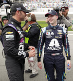 William Byron, right, is congratulated by Jimmie Johnson, left, after winning the pole position during qualifying for the Daytona 500 auto race at Daytona International Speedway, Sunday, Feb. 10, 2019, in Daytona Beach, Fla. (AP Photo/John Raoux)