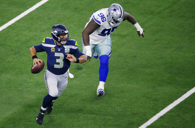 Seattle Seahawks quarterback Russell Wilson (3) runs out of the pocket against the Dallas Cowboys during the first half of the NFC wild-card NFL football game in Arlington, Texas, Saturday, Jan. 5, 2019. (AP Photo/Roger Steinman)