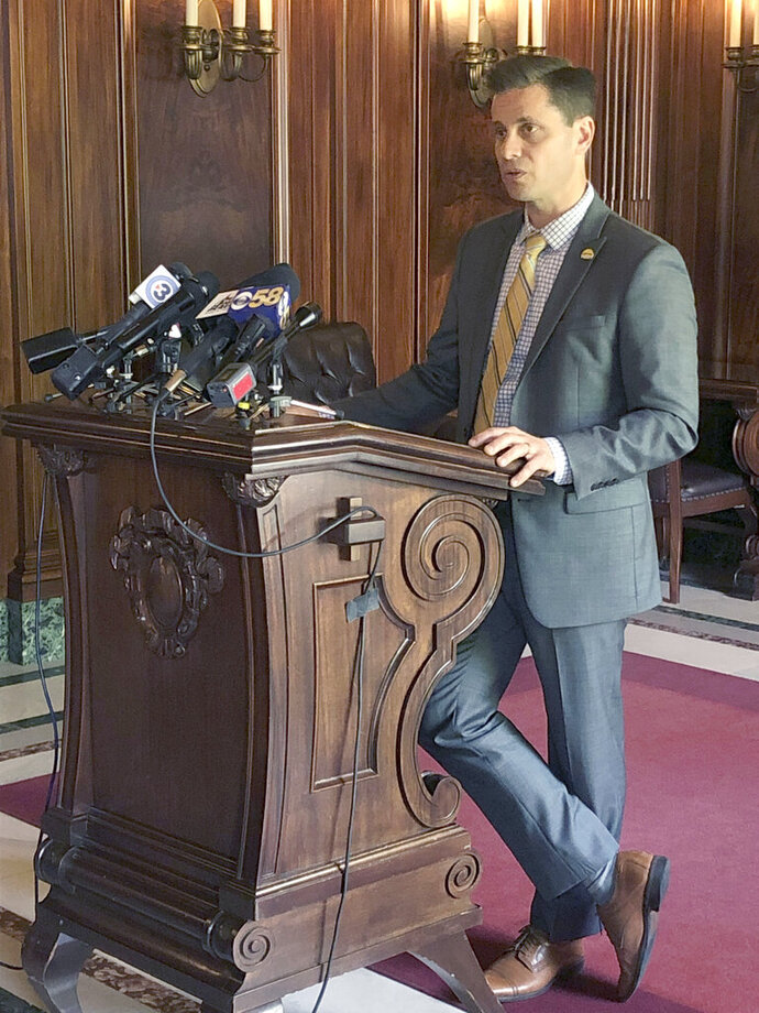 Republican Wisconsin state Sen. Chris Kapenga talks to reporters about his hobby of rebuilding Tesla vehicles during a news conference Wednesday, June 26, 2019, in Madison, Wisconsin. Kapenga says it has nothing to do with his support for the state budget that includes a provision that would allow the electric car manufacturer to sell its vehicles directly to consumers in Wisconsin. (AP Photo/Scott Bauer)