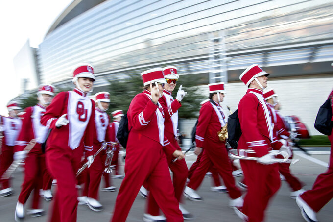 Members of the Oklahoma band enter AT&T Stadium before the Big 12 Conference championship NCAA college football game against Texas on Saturday, Dec. 1, 2018, in Arlington, Texas. (AP Photo/Jeffrey McWhorter)