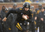 FILE - In this Nov. 23, 2018, file photo, Missouri quarterback Drew Lock runs with the ball during the first half of an NCAA college football game against Arkansas, in Columbia, Mo. Lock is a possible pick in the 2019 NFL Draft. (AP Photo/L.G. Patterson, File)
