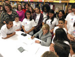 FILE - In this April 3, 2019 file photo, New Mexico Gov. Michelle Lujan Grisham signs legislation to raise teacher salaries and increase annual spending on public schools by almost a half-billion dollars at Salazar Elementary School in Santa Fe, N.M. New Mexico Democrats pushed forward a progressive agenda as the booming oil industry made headlines in 2019 with record revenues for the state's coffers.(AP Photo/Morgan Lee, File)