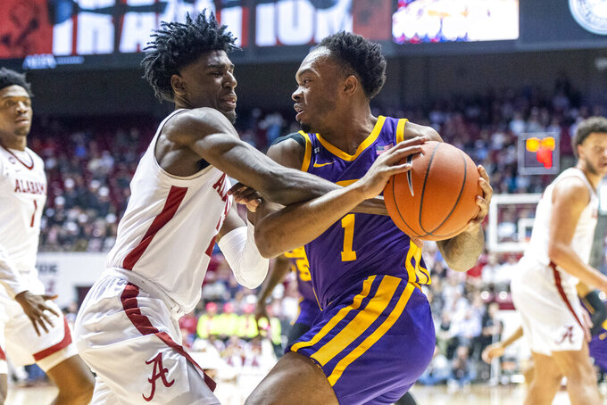 Alabama guard Kira Lewis Jr. (2) defends as LSU guard Javonte Smart (1) attacks during the first half of an NCAA college basketball game, Saturday, Feb. 15, 2020, in Tuscaloosa, Ala. (AP Photo/Vasha Hunt)