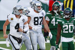 Las Vegas Raiders quarterback Derek Carr, left, celebrates his touchdown during the second half an NFL football game against the New York Jets, Sunday, Dec. 6, 2020, in East Rutherford, N.J. (AP Photo/Noah K. Murray)