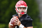 FILE - In this Aug. 2, 2019, file photo, Georgia quarterback Jake Fromm throws a pass during the team's first scheduled NCAA college football practice, in Athens, Ga. Fromm is breaking in an almost completely new corps of wide receivers after losing the Bulldogs' top five leaders in catches from 2018.(AP Photo/John Bazemore, File)