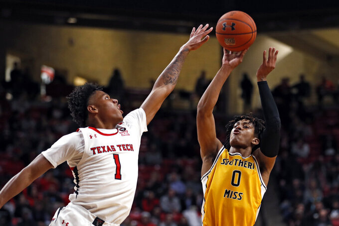 Southern Mississippi's Gabe Watson (0) shoots the ball over Texas Tech's Terrence Shannon, Jr. (1) during the first half of an NCAA college basketball game Monday, Dec. 16, 2019, in Lubbock, Texas. (Brad Tollefson/Lubbock Avalanche-Journal via AP)