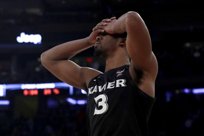 Xavier guard Quentin Goodin reacts after his team lost 71-67 to Villanova in overtime of an NCAA college basketball semifinal game in the Big East men's tournament, Friday, March 15, 2019, in New York. (AP Photo/Julio Cortez)