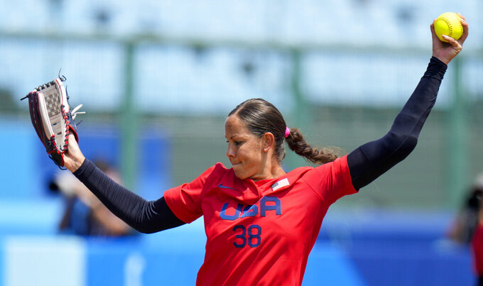United States' Cat Osterman pitches during the softball game between Italy and the United States at the 2020 Summer Olympics, Wednesday, July 21, 2021, in Fukushima , Japan. (AP Photo/Jae C. Hong)