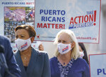 Rep. Nydia Velazquez, D-N.Y., left, and Sen. Kirsten Gillibrand, D-N.Y., join advocates for Puerto Rico which Senate Majority Leader Chuck Schumer, D-N.Y., joins advocates for Puerto Rico, which still suffers from the effects of Hurricane Maria in 2017, at the Capitol in Washington, Monday, Sept. 20, 2021. (AP Photo/J. Scott Applewhite)