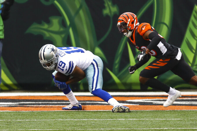 Dallas Cowboys wide receiver Amari Cooper (19) makes a catch in front of Cincinnati Bengals cornerback LeShaun Sims (38) for a touchdown in the first half of an NFL football game in Cincinnati, Sunday, Dec. 13, 2020. (AP Photo/Aaron Doster)