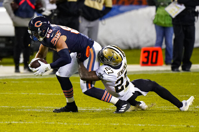 New Orleans Saints strong safety Malcolm Jenkins (27) tackles Chicago Bears tight end Jimmy Graham (80) in the second half of an NFL football game in Chicago, Sunday, Nov. 1, 2020. (AP Photo/Nam Y. Huh)