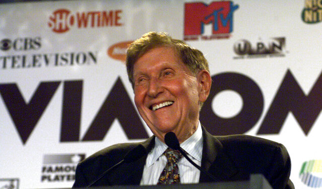 FILE - In this Sept. 7, 1999 file photo, Viacom Chairman Sumner Redstone smiles during the announcement of a merger between CBS and Viacom in New York.  Redstone, the strong-willed media mogul whose public disputes with family members and subordinates made him a feared operator in Hollywood, died Wednesday, Aug. 12, 2020.  (AP Photo/Suzanne Plunkett)