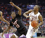 Florida State's Trent Forrest (3) drives against Virginia Tech's Ahmed Hill (13) during the first half of an NCAA college basketball game in the Atlantic Coast Conference tournament in Charlotte, N.C., Thursday, March 14, 2019. (AP Photo/Nell Redmond)