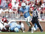 Tulane quarterback Michael Pratt (7) runs against Oklahoma during a NCAA college football game Saturday, Sept. 4, 2021, in Norman, Okla. (AP Photo/Alonzo Adams)