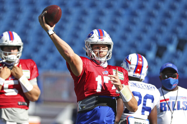 Buffalo Bills quarterback Josh Allen, center, throws a pass during NFL football training camp in Orchard Park, N.Y., Thursday, Aug. 20, 2020. (James P. McCoy/Pool Photo via AP)