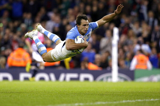 FILE - In this Oct. 18, 2015 file photo, Argentina's Juan Imhoff scores a try during the Rugby World Cup quarterfinal match between Ireland and Argentina at the Millennium Stadium, Cardiff, Wales. Imhoff is one of a host of big names to be missing the first Rugby World Cup in Asia. (AP Photo/Tim Ireland, File)