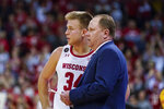 Wisconsin coach Greg Gard talks with Brad Davison during the second half of the team's NCAA college basketball game against Maryland Tuesday, Jan. 14, 2020, in Madison, Wis. Wisconsin won 56-54. (AP Photo/Andy Manis)