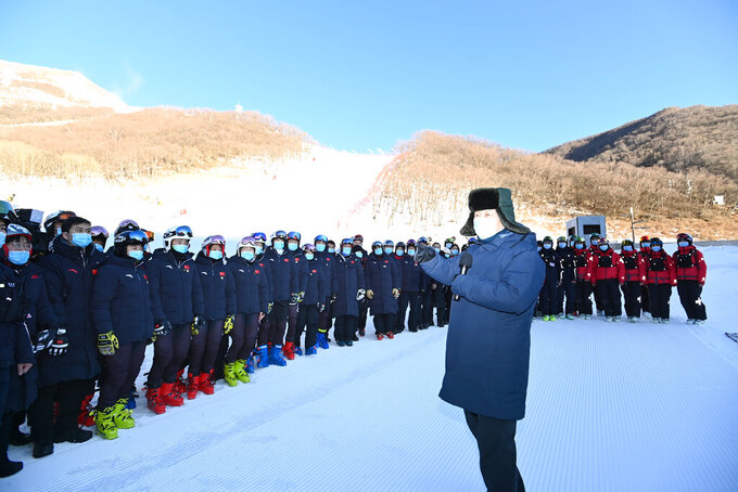 "FILE - In this Jan. 18, 2020, file photo released by China's Xinhua News Agency, Chinese President Xi Jinping speaks with athletes and coaches at the National Alpine Skiing Center in Yanqing on the outskirts of Beijing during a tour of venues and preparations for the 2022 Beijing Winter Olympics. The 2022 Beijing Winter Olympics will open a year from now. Most of the venues have been completed as the Chinese capital becomes the first city to hold both the Winter and Summer Olympics. Beijing held the 2008 Summer Olympics. But these Olympics are presenting some major problems. They are already scarred by accusations of rights abuses including ""genocide""against more than 1 million Uighurs and other Muslim ethnic groups in western China. (Ju Peng/Xinhua via AP, File)"