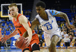 UCLA guard Kris Wilkes, right, steals the ball from Oregon State forward Tres Tinkle during the first half of an NCAA college basketball game in Los Angeles, Thursday, Feb. 21, 2019. (AP Photo/Kelvin Kuo)