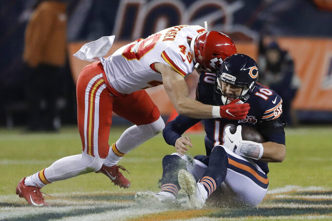 Kansas City Chiefs defensive back Daniel Sorensen (49) tackles Chicago Bears quarterback Mitchell Trubisky (10) in the first half of an NFL football game in Chicago, Sunday, Dec. 22, 2019. (AP Photo/Nam Y. Huh)