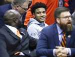 Injured Auburn forward Chuma Okeke is positioned behind the Auburn bench in a wheelchair during the second half of the Midwest Regional final game against Kentucky in the NCAA men's college basketball tournament Sunday, March 31, 2019, in Kansas City, Mo. Okeke was injured during Auburn's 97-80 win over North Carolina Friday. (AP Photo/Orlin Wagner)