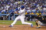 Los Angeles Dodgers' Max Muncy connects for a two-run home run during the first inning of the team's baseball game against the Pittsburgh Pirates on Wednesday, Aug. 18, 2021, in Los Angeles. (AP Photo/Marcio Jose Sanchez)