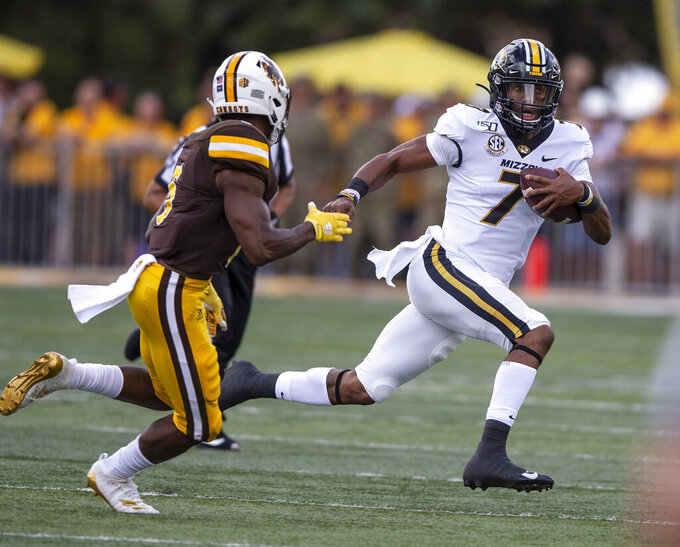 Missouri quarterback Kelly Bryant (7) runs the ball against the Wyoming defense in the first quarter of an NCAA college football game, Saturday, Aug. 31, 2019. in Laramie, Wyo. (AP Photo/Michael Smith)