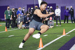 FILE - Northwestern offensive lineman Rashawn Slater, participates in the school's Pro Day football workout for NFL scouts Tuesday, March 9, 2021, in Evanston, Ill. The acquisition of Sam Darnold via trade earlier this month has given the Carolina Panthers more options with the No. 8 pick in the NFL draft. Carolina's most pressing need entering the draft is at left tackle, a position they have failed to solidify over the last seven seasons. (AP Photo/Charles Rex Arbogast, File)
