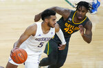 Washington's Jamal Bey (5) drives around Baylor's Davion Mitchell (45) during the second half of an NCAA college basketball game Sunday, Nov. 29, 2020, in Las Vegas. (AP Photo/John Locher)
