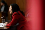 Minister of International Trade Mary Ng participates in a news conference in Ottawa, on Saturday, Nov. 21, 2020.  The U.K. signed an interim trade deal with Canada on Saturday, the second major agreement the country has reached as negotiators hurry to cement trading relationships in preparation for life outside the European Union.  (Justin Tang/The Canadian Press via AP)