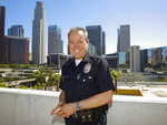In this Wednesday, July 10, 2019, photo Los Angeles Police Department Chief Michel Moore poses for a photo in downtown Los Angeles. The Los Angeles police chief said he hopes in the coming weeks the city will eliminate old bench warrants for thousands of homeless people, a move he believes can be part of the solution to get part of the population off the streets. (AP Photo/Damian Dovarganes)