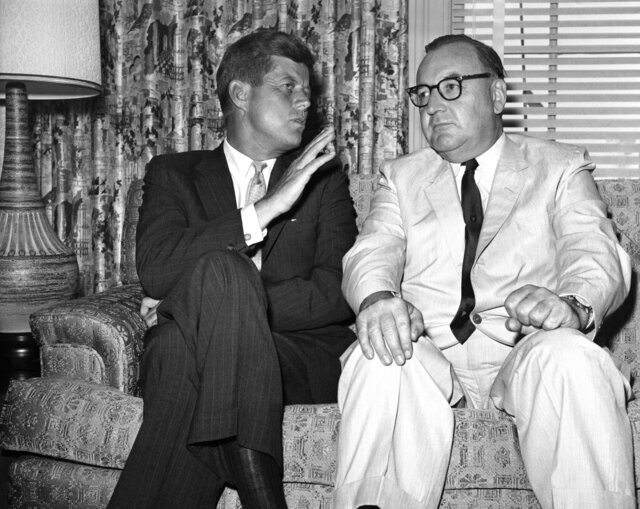 FILE - In this July 10, 1960, file photo, Sen. John F. Kennedy of Massachusetts gestures during his meeting with California Gov. Edmund G. (Pat) Brown in Los Angeles. Former California Gov. Jerry Brown wants to know who is trying to sell his father's memorabilia related to the assassination of President John F. Kennedy. Private letters and other items that had belonged to Edmund G.