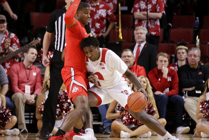 Nebraska's Kevin Cross (1) leans into Ohio State's Kaleb Wesson, left, during the first half of an NCAA college basketball game in Lincoln, Neb., Thursday, Feb. 27, 2020. (AP Photo/Nati Harnik)