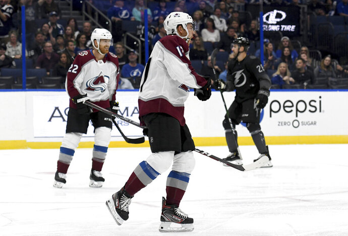 Colorado Avalanche center Tyson Jost (17) celebrates his first period goal during an NHL hockey game against the Tampa Bay Lightning Saturday, Oct. 19, 2019, in Tampa, Fla. (AP Photo/Jason Behnken)