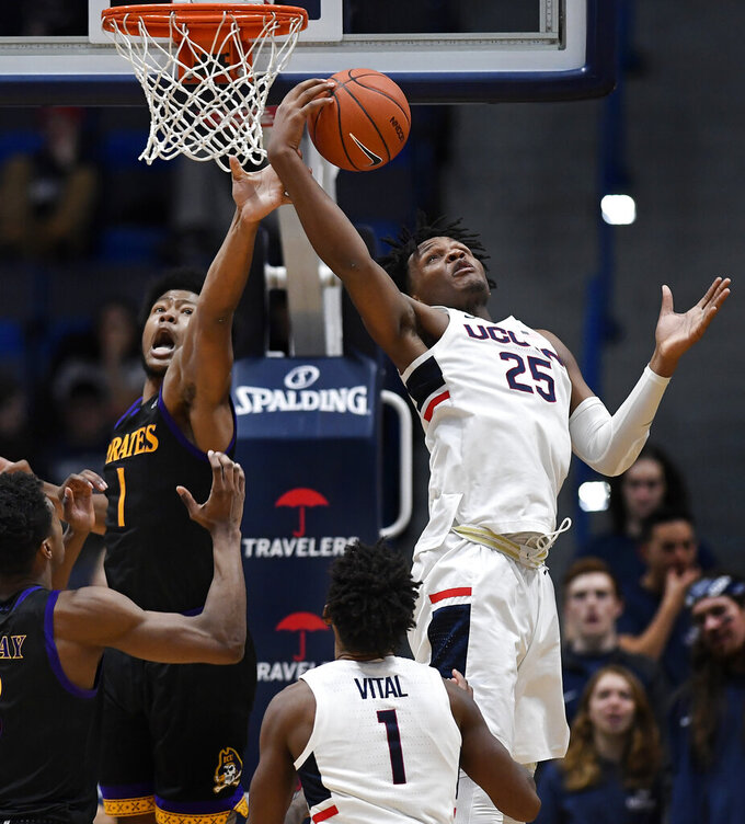 Connecticut's Josh Carlton (25) pulls down a rebound over East Carolina's Jayden Gardner, top left, during the second half of an NCAA college basketball game, Sunday, Feb. 3, 2019, in Hartford, Conn. (AP Photo/Jessica Hill)