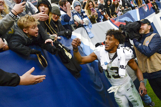 New Orleans Saints wide receiver Michael Thomas signs autographs after an NFL football game against the Tennessee Titans Sunday, Dec. 22, 2019, in Nashville, Tenn. The Saints won 38-28. (AP Photo/Mark Zaleski)