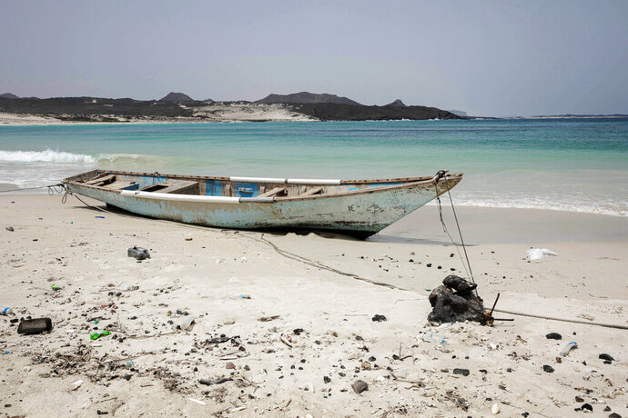 This July 27, 2019 photo shows a boat docked on the shores of Bir Ali, where migrants from Bosaso, Somalia arrive, in Shabwa, Yemen. Las Anoud, isolated in Somalia's deserts, the town is the hub for traffickers transporting Ethiopians to Yemen. It is also a center for brutal torture, according to multiple migrants. (AP Photo/Nariman El-Mofty)