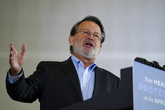 FILE - In this Oct. 16, 2020, file photo, Sen. Gary Peters, D-Mich., speaks during an event with Democratic presidential candidate and former Vice President Joe Biden at Beech Woods Recreation Center, in Southfield, Mich. (AP Photo/Carolyn Kaster, File)