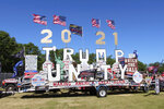 A display on a trailer is parked at a rally organized by pillow salesman-turned conspiracy peddler Mike Lindell in New Richmond, Wis., on Saturday, June 12, 2021. Talk of former President Donald Trump being reinstated, even though there is no legal or Constitutional mechanism for that happening, was common at the weekend MAGA rally in western Wisconsin. (AP Photo/Jill Colvin)